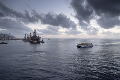 Oil Rigs and fast Ferry Royalty Free Stock Images