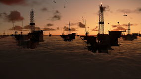 Oil rigs in ocean. At sunrise, timelapse stock video footage