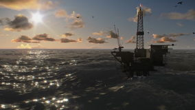 Oil rigs in ocean. At sunset, timelapse stock video footage