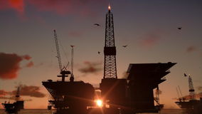 Oil rigs in ocean, time lapse sunrise, stock footage. Video royalty free illustration