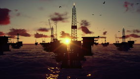 Oil rigs in ocean, time lapse sunset, stock footage. Video royalty free illustration