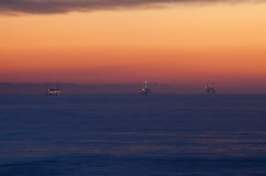 Oil rigs in the Pacific ocean. Oil rigs out in the Pacific Ocean Stock Photos