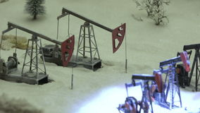 Oil rigs in the snow. ST. PETERSBURG - JULY 2016: Oil rigs in the snow in small city, Russia. The Grand Maket, which opened in 2011, is a 1:87 scale replica of stock footage
