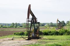Oil rigs work in the field Stock Images