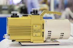 Oil rotary vane pump or vacuum pump for high pressure for industrial on the table.  stock image