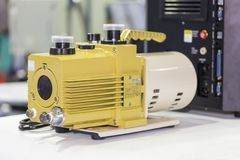 Oil rotary vane pump or vacuum pump for high pressure for industrial on the table.  royalty free stock photos
