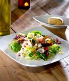Oil and salad. Salad for light lunch on the wooden Royalty Free Stock Photography