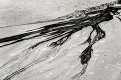 oil and sand beach Royalty Free Stock Photo