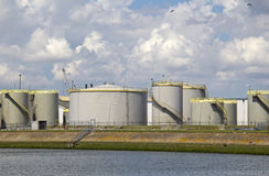 Oil silos along a canal Stock Photo
