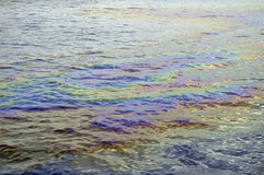 Oil slick iridescent rainbow Stock Images