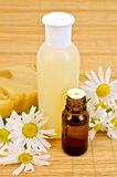 Oil and soap with chamomile Stock Photo