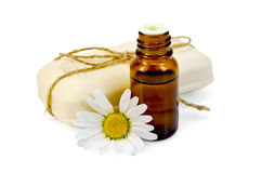 Oil and soap white with chamomile Stock Images