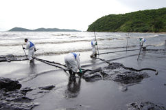 Oil spill on the Ao Prao beach, Koh Samet Island. royalty free stock photo