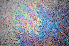 Oil spill on asphalt road Stock Photos