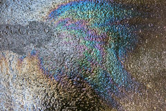 Oil spill on asphalt Royalty Free Stock Images