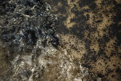 Oil spill on beach Royalty Free Stock Photos