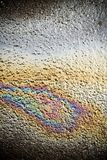 Oil spill on road, petrol concept Stock Images