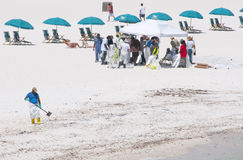 Oil spill workers cleaning beach Stock Photos