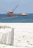 Oil spill workers at seashore. ORANGE BEACH, AL - JUNE 10: Oil spill workers clean up the wash-ashored oil as the beaches in the tourist resort Orange Beach, AL Stock Photo