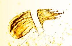 Oil splash on gold bokeh background. 3d rendering Stock Image