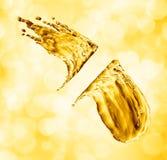 Oil splash on gold bokeh background. 3d rendering Stock Photography