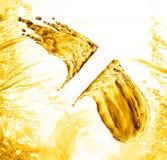 Oil splash on gold bokeh background. 3d rendering Royalty Free Stock Images