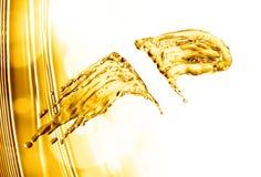 Oil splash on gold bokeh background. 3d rendering Stock Images