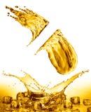 Oil splash on gold bokeh background Stock Image