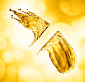 Oil splash on gold bokeh background Royalty Free Stock Photography