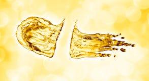 Oil splash on gold bokeh background. 3d rendering Stock Photo