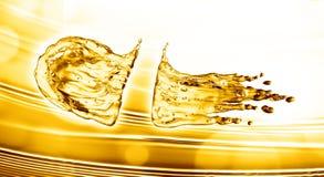 Oil splash on gold bokeh background. 3d rendering Royalty Free Stock Photo