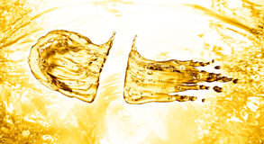 Oil splash on gold bokeh background. 3d rendering Royalty Free Stock Image