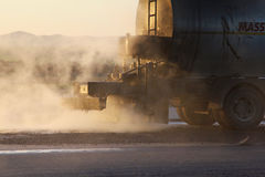 Oil spreader truck applying tack coats on a surface in preparation for paving Stock Image