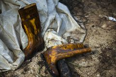 Oil stained boots Stock Images