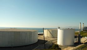 Oil storage. Tanks at a refinery on the sea Stock Images