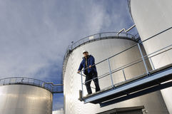 Oil storage and engineer Stock Photo