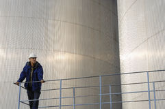 Oil storage and engineer Royalty Free Stock Image