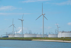 Oil storage facility with Modern Dutch Windmills Stock Image