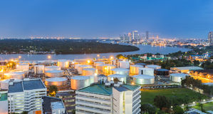 Oil storage tank along with river at night Stock Images