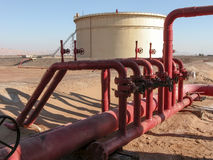 Oil Storage Tank and Pipework in Facility in Sinai. Oil Storage Tank and Pipework Manifold in Facility in Sinai, Egypt royalty free stock image