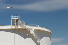 Oil storage tank with windsock. On top Royalty Free Stock Images