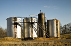 Oil Storage tanks. By a country road Royalty Free Stock Images
