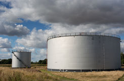 Oil storage tanks. Under a cloudy sky Stock Photography