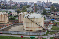 Oil storage tanks at urban place Royalty Free Stock Photo