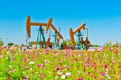 Oil sucking machine _ anthemy _ blue sky Stock Photos