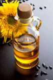Oil with sunflowers Royalty Free Stock Image