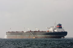 Oil supertanker ship at sea with pilot boat. Stock Photo