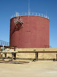 Oil tank. Photo of oil tank at industrial site with nice blue sky Stock Photos