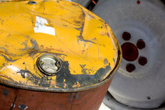 Oil Tank. Used Oil Tank lay in The Garage show Yellow Cover and Red Tank Stock Images