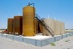 Oil tank battery. Oil industry tank battery operations Royalty Free Stock Photo